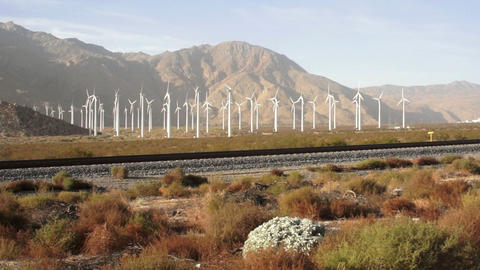A fast motion shot of the sun shining on the valley and wind turbines in Califor Footage