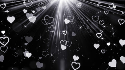 Hearts And Stars Flying In Light Rays Loop 4k (4096x2304) stock footage