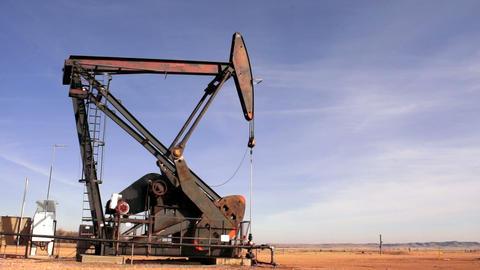 North Dakota Oil Pump Jack Fracking Crude Extraction Machine Footage