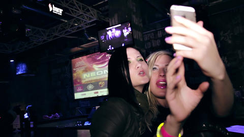 Two Young Women Making Selfie With Cell Phone On Club Party stock footage
