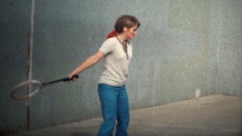 (8mm Vintage) 1971 Women Playing Tennis Against Wall stock footage