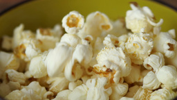 Pouring Popcorn Into a Yellow-Mustard Bowl Footage