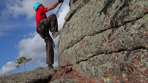Climber On The Cliff stock footage