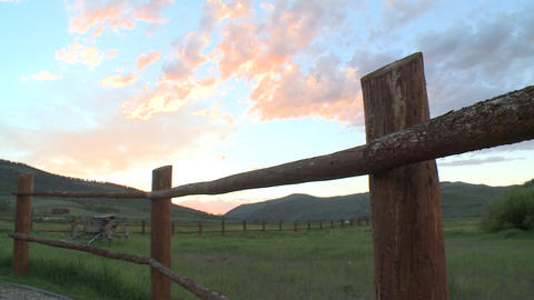 sunset over mountain in Colorado western sky with perspective fence Live Action