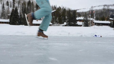young girl ice skating on frozen pond- skates, spins and twirls Live Action