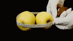 Apples measuring tape metaphor Footage