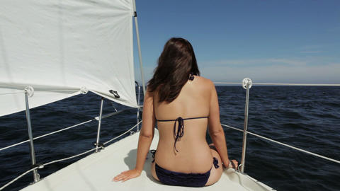 Young woman enjoying the sun and the sea Footage