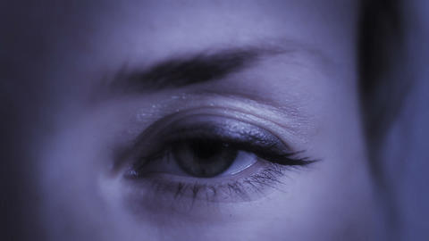 Eye Slowly Opens On Young Woman stock footage