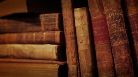Old books in a bookshelf Footage