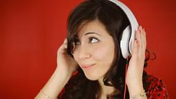 Music woman headphones flirting kissing regretful Footage