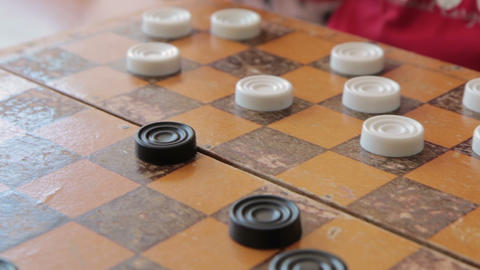 Children play checkers in classroom Footage