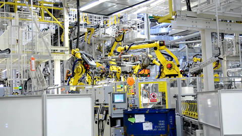 Working yellow robotic arms in the factory Footage
