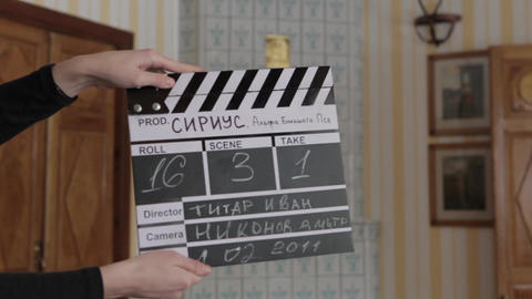 movie clapper, old mansion in the Ukrainian style 19th century against the backg Footage
