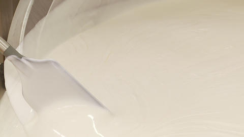 Close Up Of Milky Cosmetics Lotion- Lab Tech Paddles More stock footage