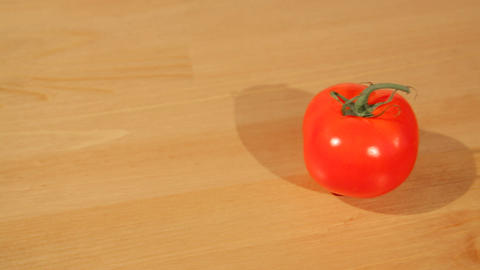 A tomato on a cutting board Footage