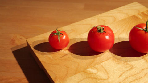 A row of tomatoes aligned by size Footage