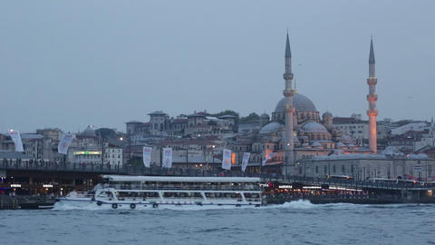 Galata Bridge And Mosque Eminonu ( New Mosque) In The Evening stock footage