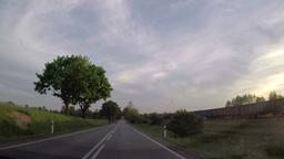driving car through non urban road, casing train Footage