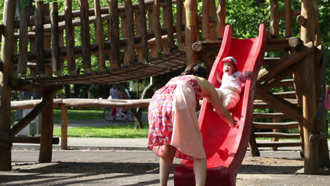 Baby Slide Fun in Park Footage