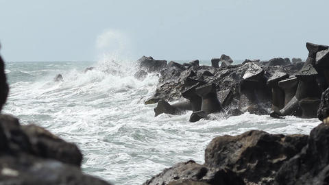 Big Waves Break on Rocks Footage