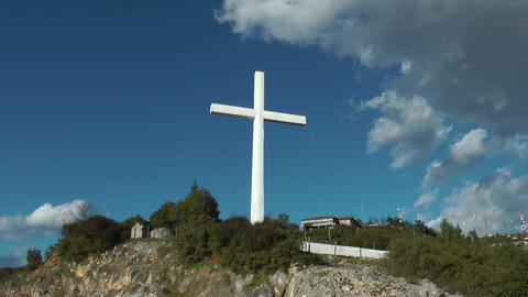 Timelapse video of a cross on hill Footage