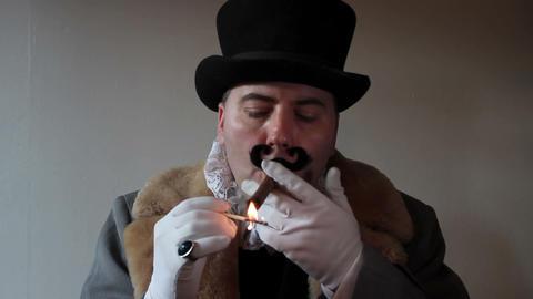 Capitalist Lighting A Cigar 2 stock footage