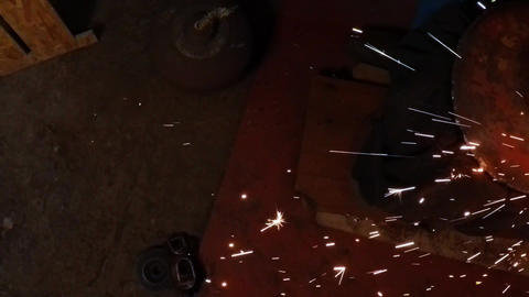 Angle Grinder strike sparks in the dark Footage