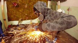Angle Grinder strike sparks in the dark Footage