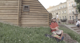 street musician playing on a makeshift drum among people passing by Footage
