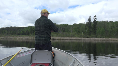 Man Casting out of Front of Fishing Boat Footage