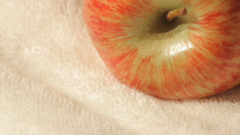 Sliding view of an apple on a white towel Footage