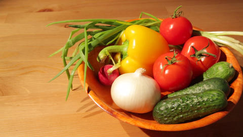 Multiple vegetables on a wooden plate Footage