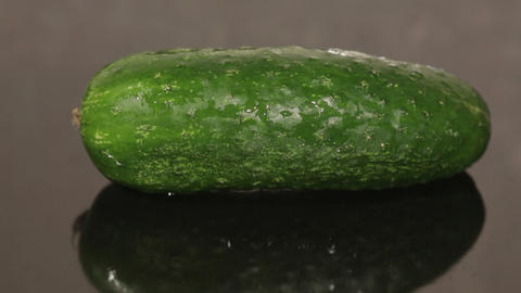 A cucumber on a black pan closeup Footage