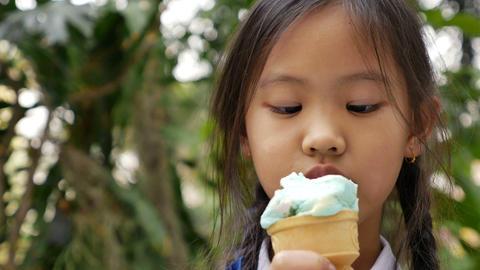 4K Video of little Asian girl enjoying her ice cream Footage