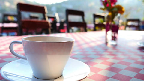 4K Ultra HD : Coffee up with steam on the table Footage
