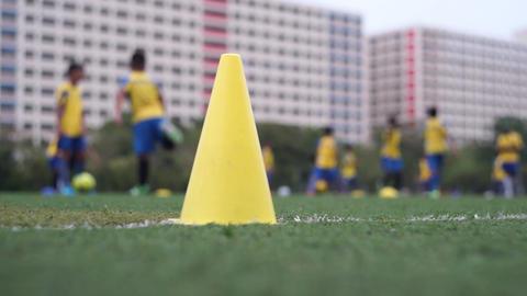 Football team practicing in field Footage