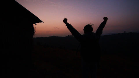 Silhouette Of Asian Man Victory Hands Up At Sunrise On The Mountain stock footage