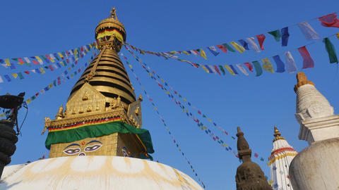 KATHMANDU, NEPAL - March 19, 2015 : The Swayambhunath Stupa with blue sky in sun Footage