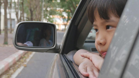 Sadness Asian Girl Looking Out From Car Window stock footage