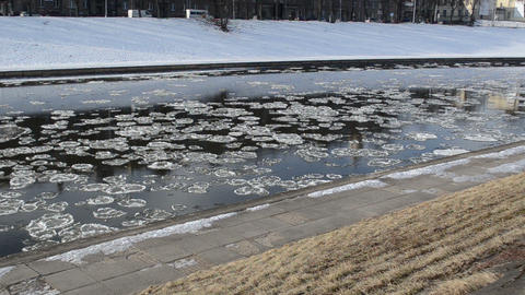river with the floating piece of ice in first days of spring Footage