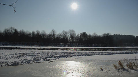 frozen river neris in winter sunlight and floating floe in water Footage