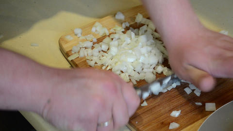 hands cut onion with knife on board. healthy food prepare Footage