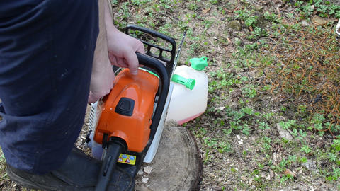 unsuccessful attempt to start chainsaw on stump Footage
