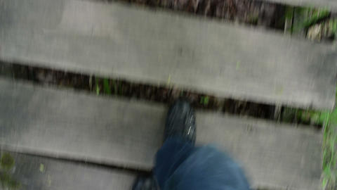 man legs with black shoes climb up wooden old staircase park Footage