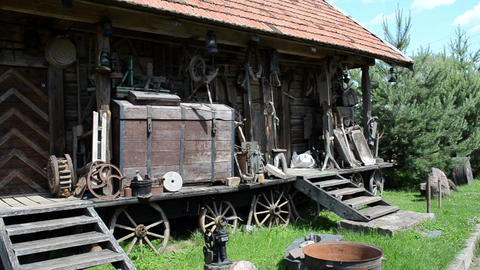 old retro rural equipment tools chest wheels old rural log house Footage