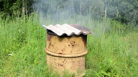 smoke rises rusty smokehouse barrel asbestine slate roof Live Action