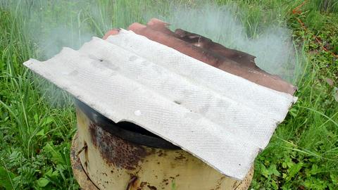 Smoke Rises Rusty Smokehouse Barrel Slate Roof stock footage