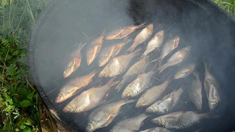 closeup ecologic fish smoked in smokehouse and smoke rise Footage