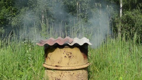 smoke rise smoke house rusty barrel asbestine slate roof Live Action