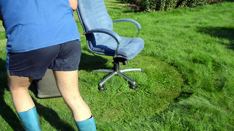 concept man short rubber boot lawn cutter office boss chair Footage